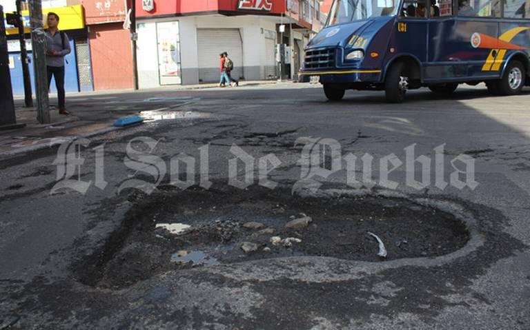Baches, un dolor de cabeza en las calles de Puebla