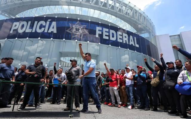 Continúan negociaciones con policías federales