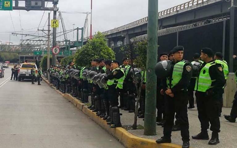 Policías federales anuncian que no marcharán al AICM; dialogarán con autoridades