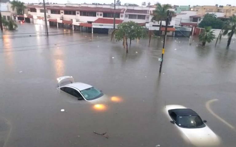 Lluvia deja inundaciones y desbordamiento de canales en Mazatlán