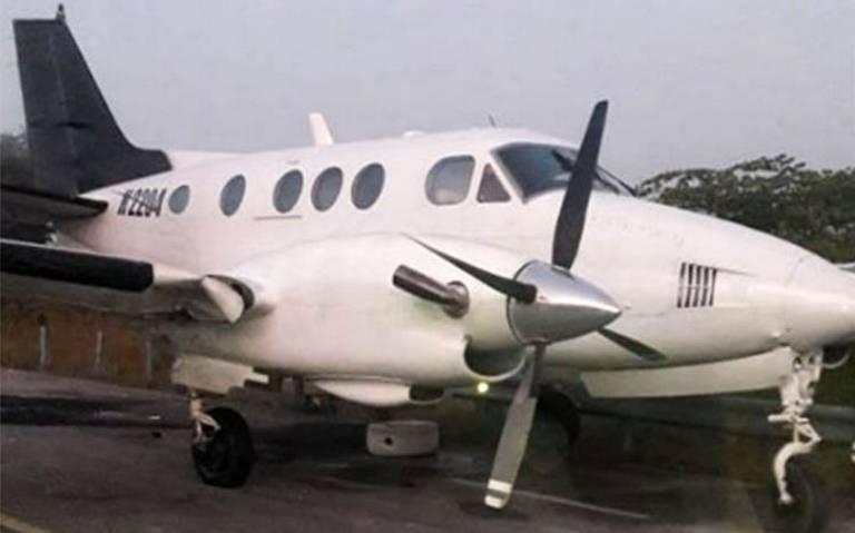 Dos detenidos tras asegurar avioneta con droga y armamento en Q. Roo