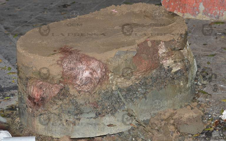 Encuentran restos humanos en bloque de cemento, en la Cuauhtémoc