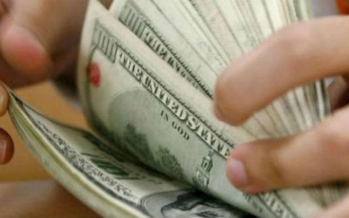 Dólar cede terreno, se vende en 18.81 pesos en bancos de la ciudad