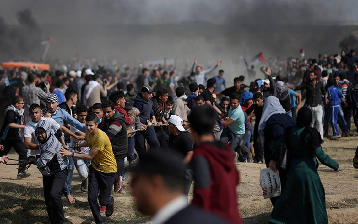 Tres palestinos muertos y 75 heridos por fuego israelA� en protestas de Gaza