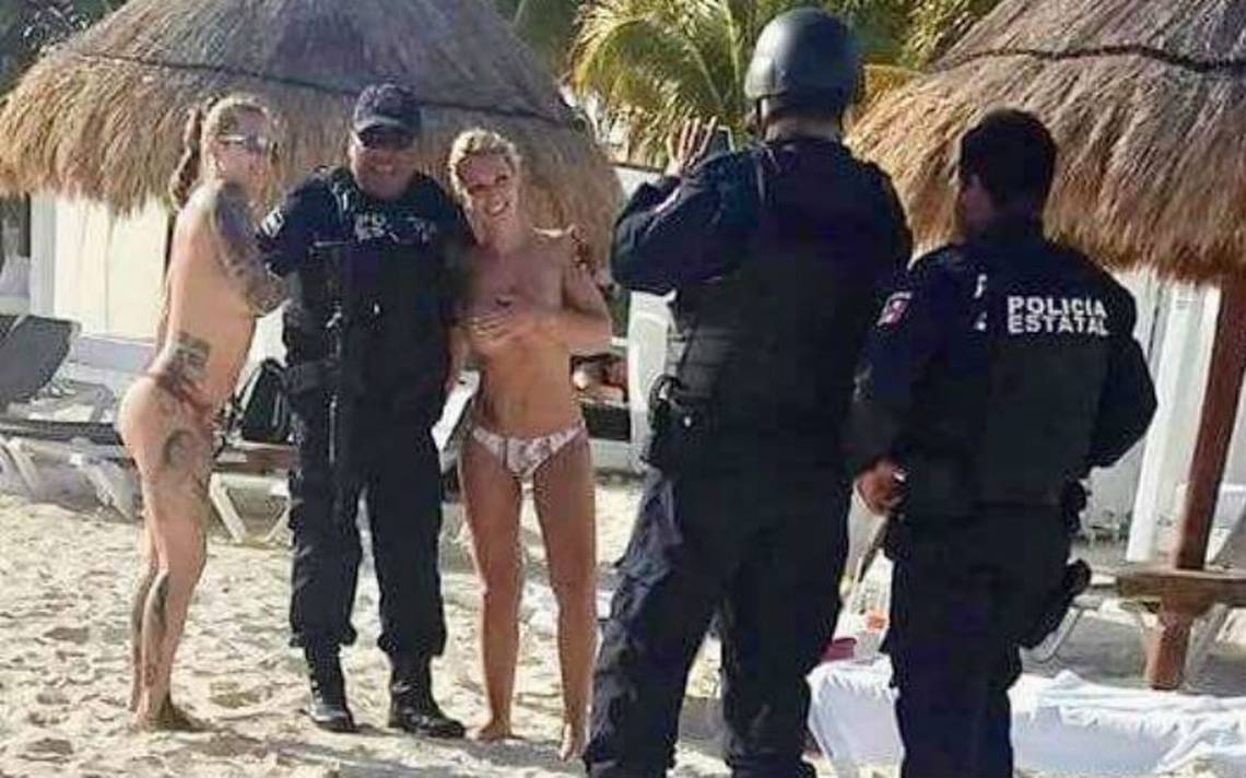 Sancionarán a polis que se tomaron fotos con spring breakers  en topless