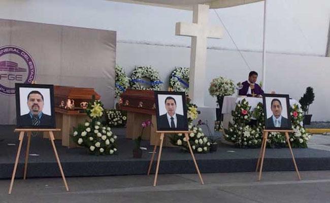 Realizan funeral de agentes de Puebla asesinados
