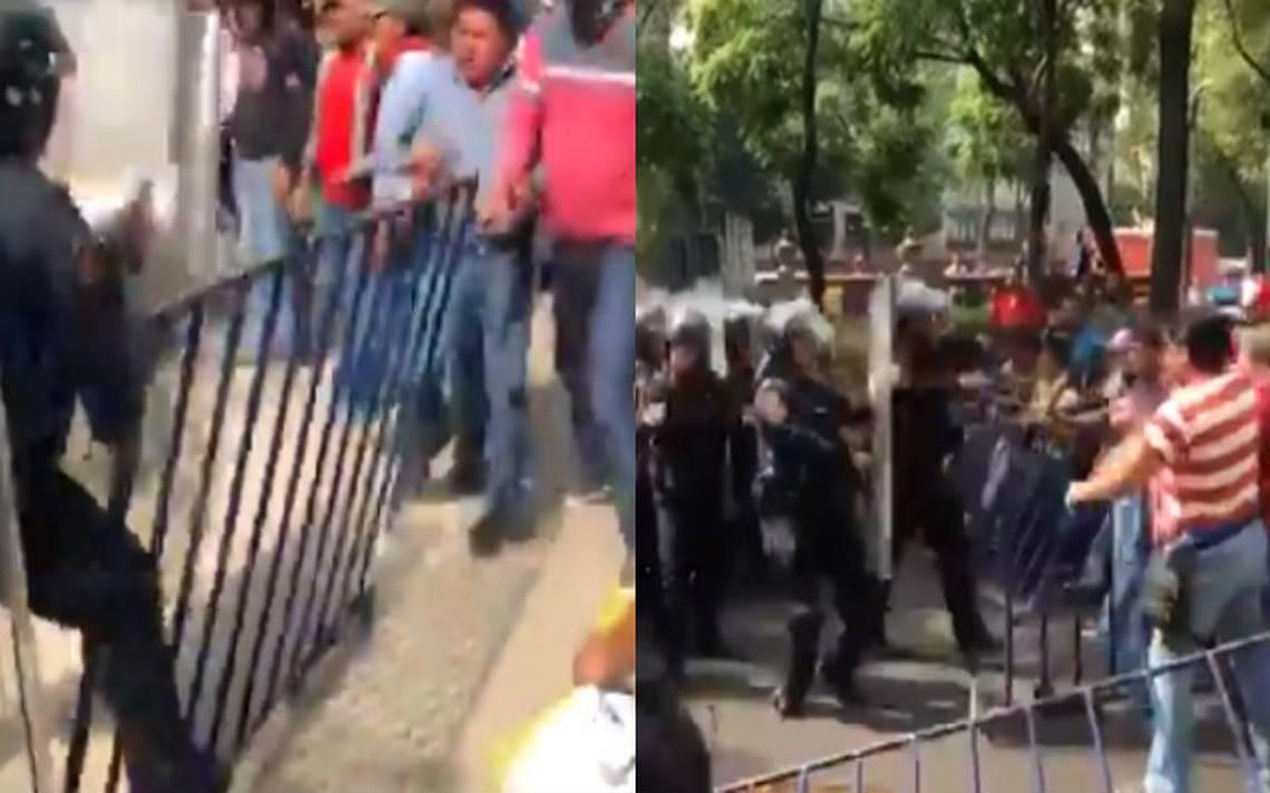 CNTE y policías se enfrentan en la embajada de EU