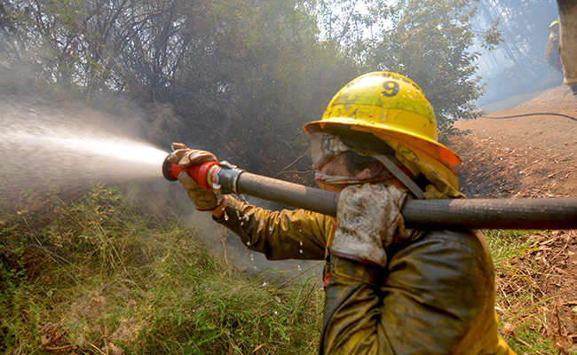 Reconstruir casas quemadas en Chile, tomará más de un año