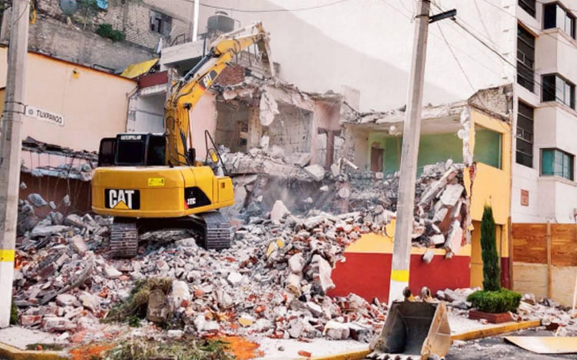 Suman 57 edificios derrumbados tras sismo del 19S