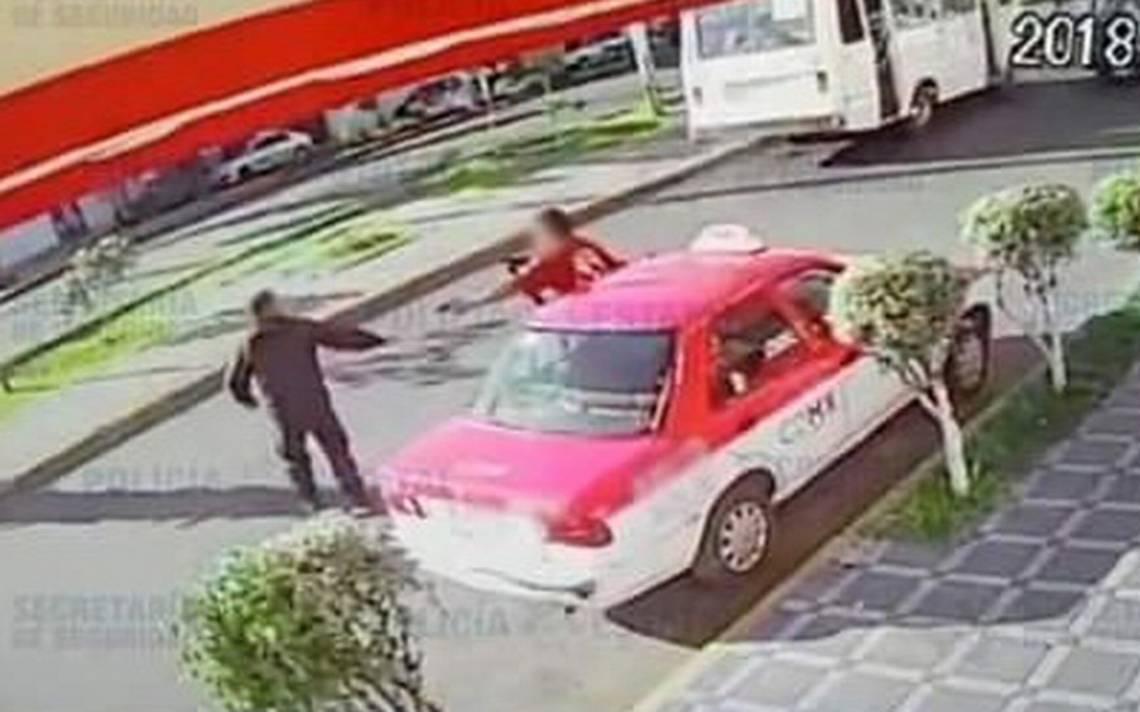 [Video] Taxista roba pistola a policA�a que intentaba detenerlo por asalto