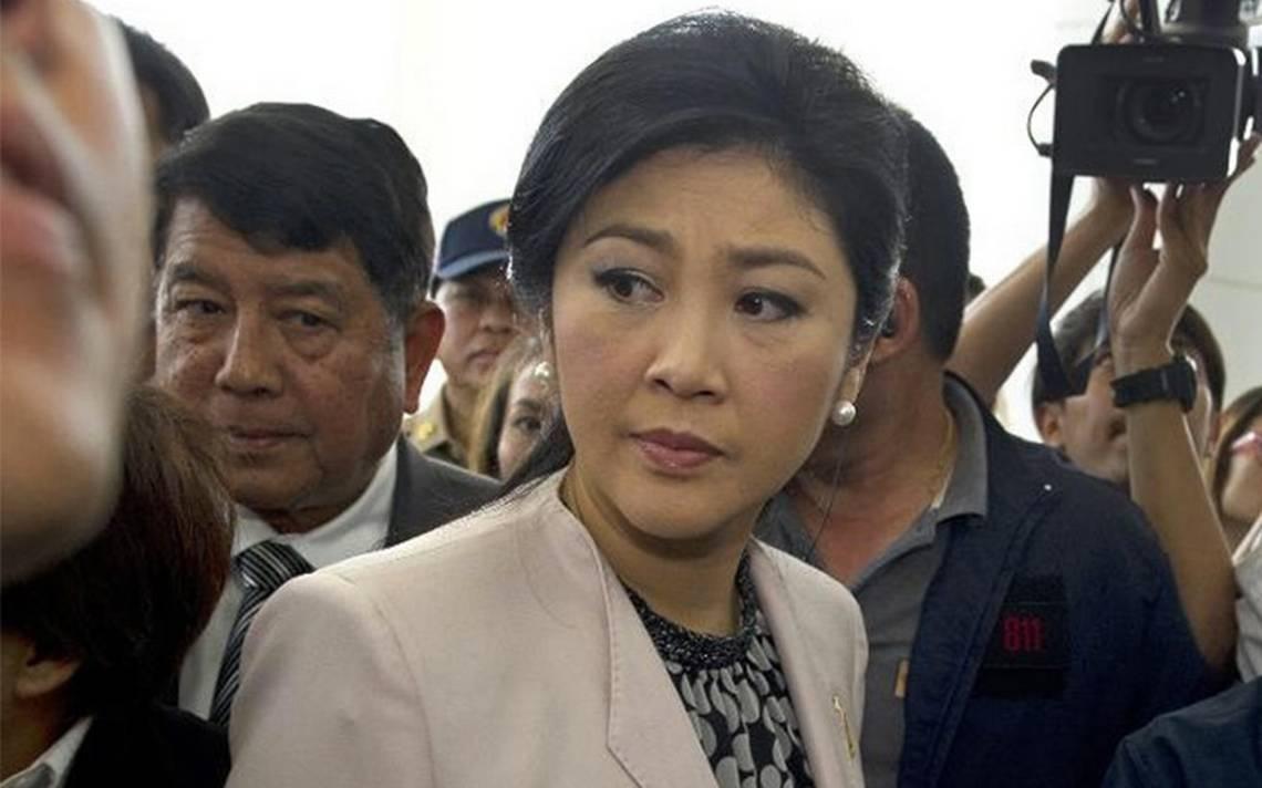 Exprimera ministra tailandesa huye del país para evitar la prisión