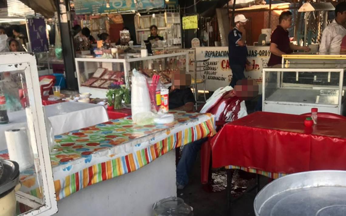 La última comida: ejecutan a tres personas en mercado de Iguala