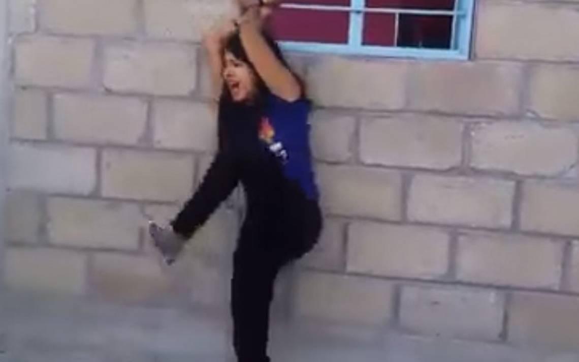 Azotan a mujer con una manguera tras supuesta infidelidad