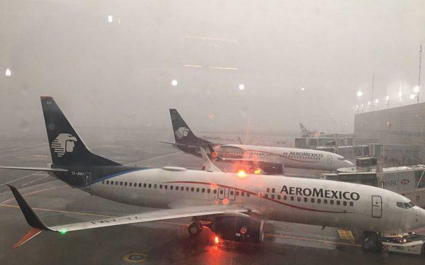 Al menos 150 vuelos del AICM afectados por tromba en el Valle de México