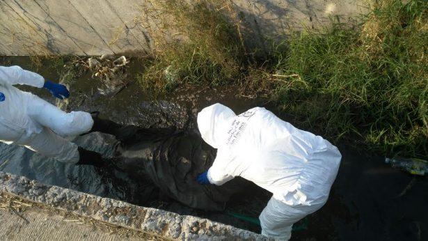 Hallan cadáver embolsado en Tlajomulco