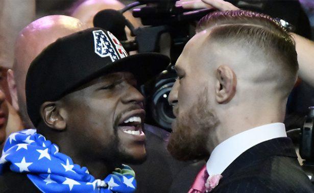 """Se """"agarran"""" a dimes y diretes McGregor y Mayweather"""