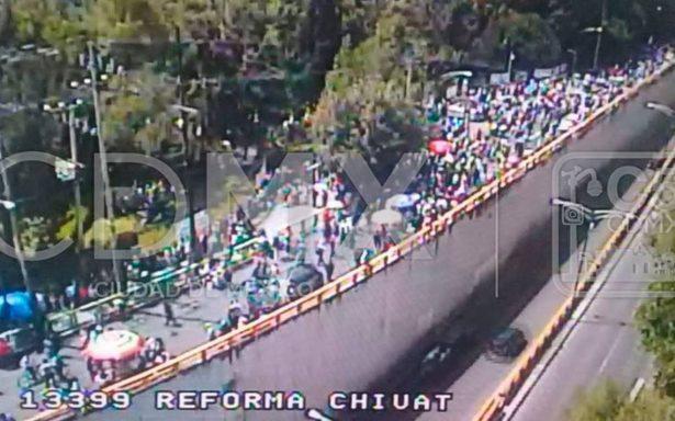 Manifestantes bloquean Paseo de la Reforma; se dirigen a Los Pinos