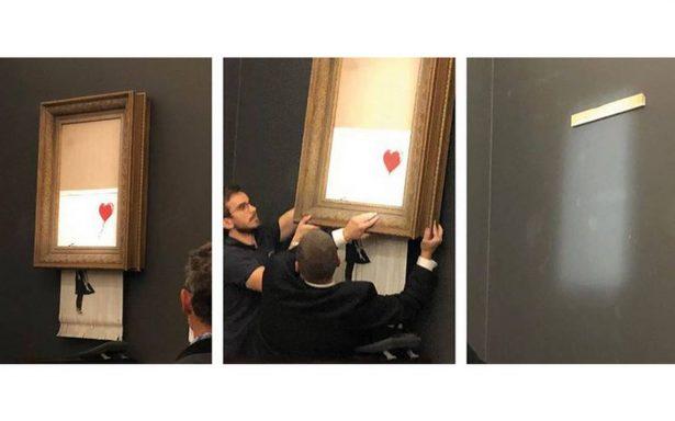 ¡Increible! Obra de Banksy cobra vida y se autodestruye en subasta