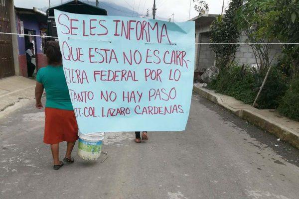 Bloquean acceso a Ixhuatlán del Café