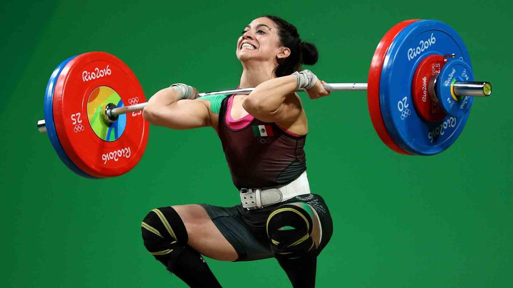 RIO DE JANEIRO, BRAZIL - AUGUST 08:  Monica Patricia Dominguez Lara of Mexico competes during the Women's 58kg Group A weightlifting contest on Day 3 of the Rio 2016 Olympic Games at the Riocentro - Pavilion 2 on August 8, 2016 in Rio de Janeiro, Bra  (Photo by Lars Baron/Getty Images)