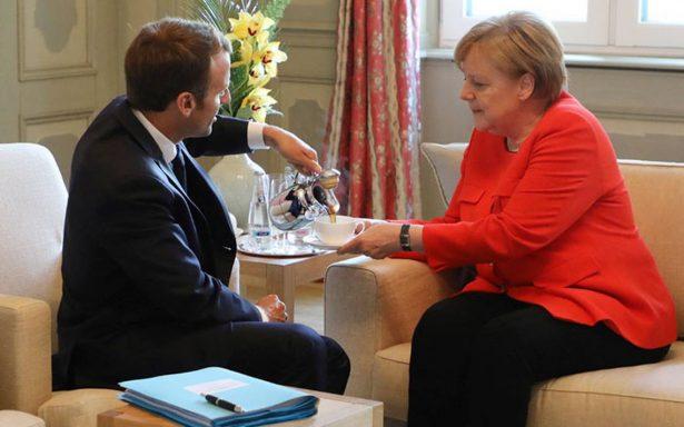 Merkel y Macron pactan por mayor control fronterizo y presupuesto común