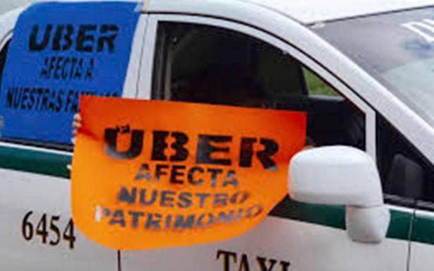Congreso de Q. Roo pone en la mesa ley para regular a Uber; taxistas protestan
