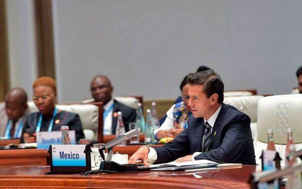 Prioritario defender libre comercio, destaca Peña Nieto en China