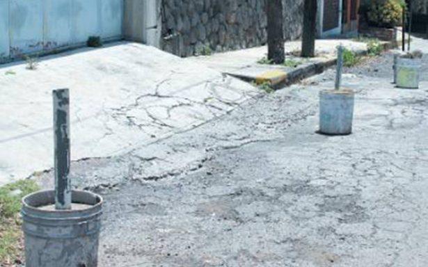 Hallan cubetas rellenas de restos humanos en Venustiano Carranza