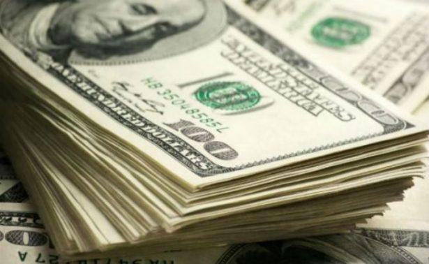 Dólar baja, se vende hasta en 18.58 pesos en bancos de la capital