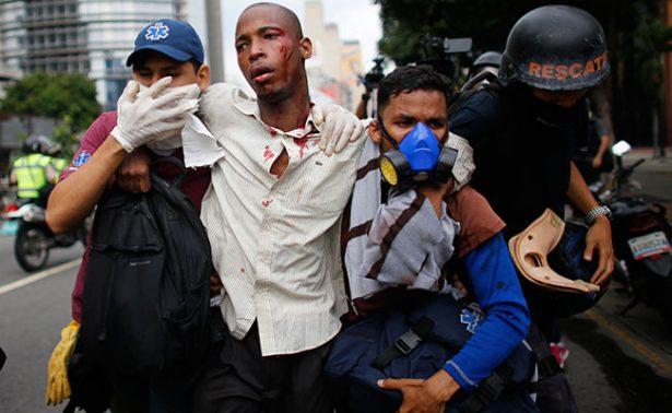 En Venezuela asciende a 21 los muertos por violentas protestas y saqueos