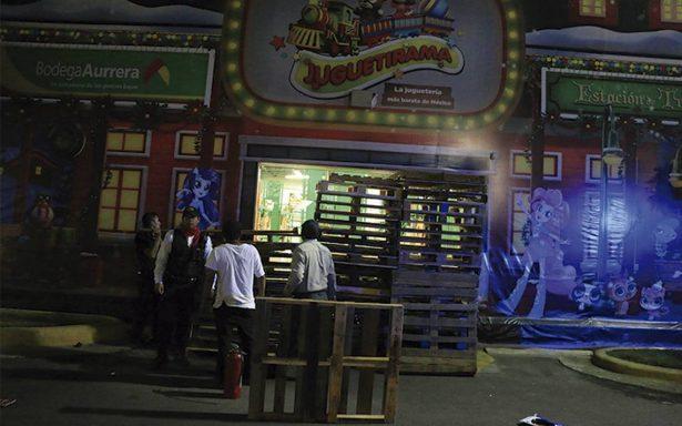 Comerciantes acusan a vecinos de saquear tiendas