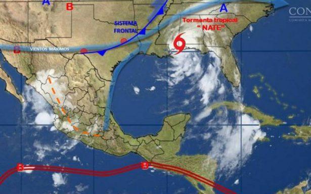 Huracán Nate se debilita a tormenta tropical tras tocar tierra