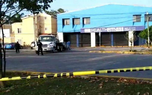 Hallan cinco cuerpos dentro de un auto en Cancún
