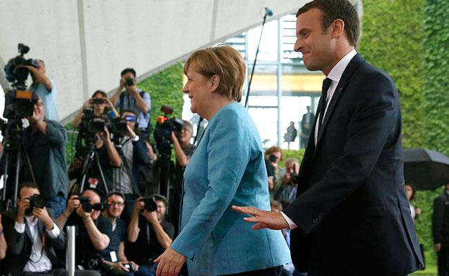 Merkel y Macron. Foto: EFE