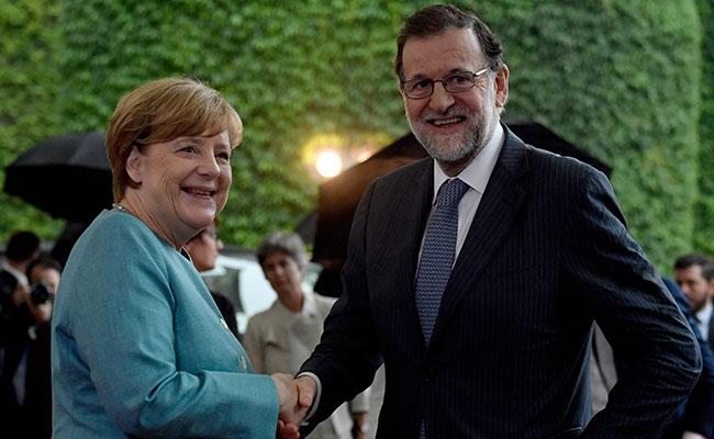 Merkel recibe a Rajoy. Foto: AFP