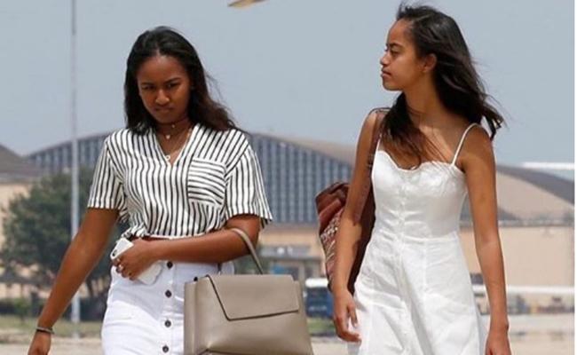 Esposa Michelle y sus hijas Malia y Sasha