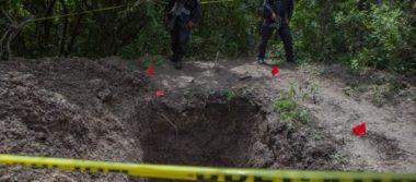 Localizan tres cuerpos en una fosa clandestina en Coahuayana