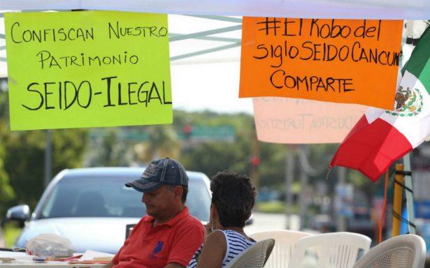 Usuarios de cajas de seguridad de Cancún amagan con cerrar acceso a zona hotelera