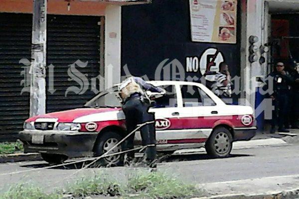 Hallan cuerpos en taxi en Ciudad Mendoza