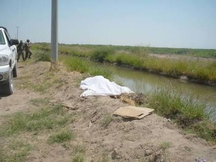 Reportaron un ahogado en canal, pero al sacarlo encontraron que había sido degollado