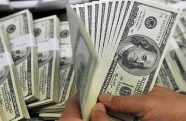 Dólar cede terreno, abre en 18.65 pesos en bancos de la Ciudad de México