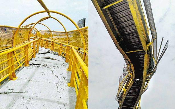 Choca grúa contra puente en Edomex