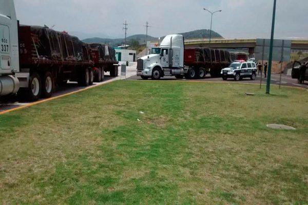 Recuperan camiones que eran propiedad de la cementera Cruz Azul