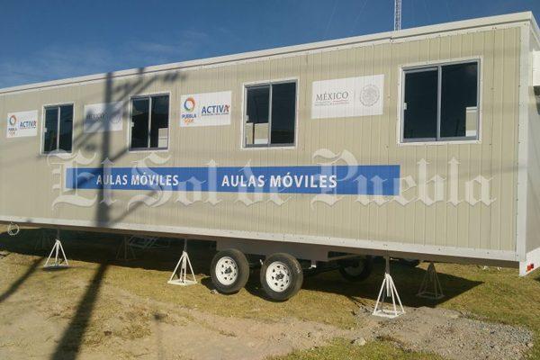 Sin mobiliario, llegan aulas móviles a Tlaltenco para escuela afectada por sismo