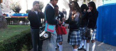 Padres apoyan revisión de mochilas