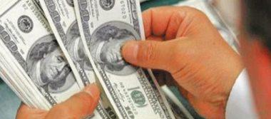 Promedia dólar en 21.75 pesos a la venta en aeropuerto de la CDMX