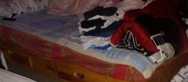 Hallan degollados a 4 integrantes de familia en Coacalco