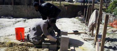 Con 22 casas inició la villa haitiana, edificada por ellos