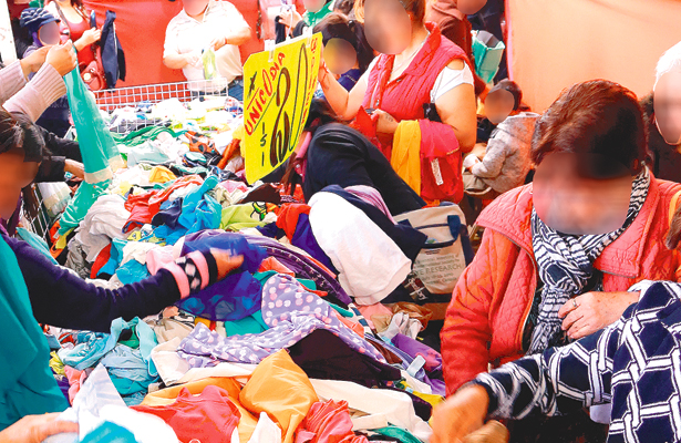 Crisis impulsa la compra de ropa asiática o de paca