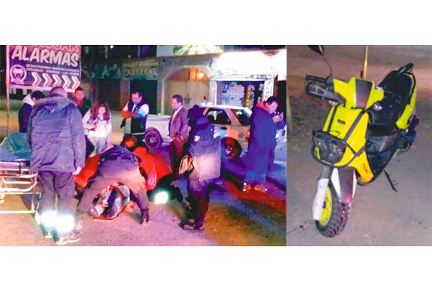 Hermanos en motoneta, arrollados por vehículo